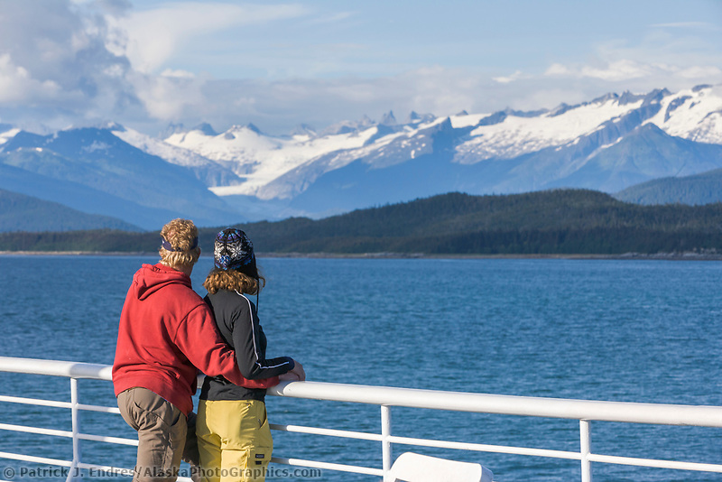 Tourists enjoy mountain views near Juneau Alaska, from the deck of the Matanuska, one of the Alaska State Ferry vessels.