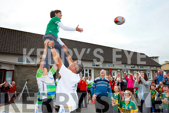 Principal of Tarbert National School Catherine Kearney was lifted into the air by All Black rugby legend Zinzan Brooke and former Ireland professional rugby player Liam Toland on Wednesday on a stop off of the Cross Atlantic Cycle in support of Cross Charity and Cancer Research at Trinity College and St. James Hospital.