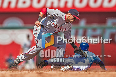 25 August 2013: Washington Nationals shortstop Ian Desmond is unable to tag a sliding Jarrod Dyson as the Kansas City Royals outfielder steals second  during a game at Kauffman Stadium in Kansas City, MO. The Royals defeated the Nationals 6-4, to take the final game of their 3-game inter-league series. Mandatory Credit: Ed Wolfstein Photo *** RAW (NEF) Image File Available ***
