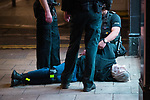 © Joel Goodman - 07973 332324. 26/09/2017. Brighton, UK. Police detain , handcuff , bind the legs and put a hood over the head of a man outside a branch of Subway , after a fight in Steine Gardens in the Kemptown area of the city . Revellers at the end of a night out in Brighton during Freshers week , when university students traditionally enjoy the bars and clubs during their first nights out in a new city . Photo credit : Joel Goodman