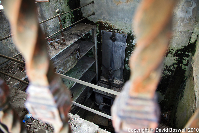 An open, decaying crypt is testament to the neglect many tombs in the Cementario de la Recoleta suffer.  The cemetary is located in the Recoleta Barrio of Buenos Aires, Argentina.