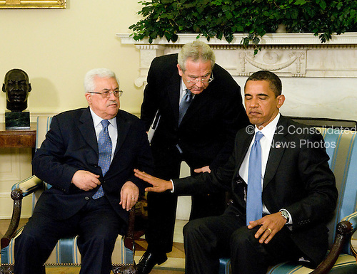 Washington, D.C. - May 28, 2009 -- United States President Barack Obama, right, through interpreter Gamal Helal, center, listens to a thought from President Mahmoud Abbas (Abu Mazen) of the Palestinian National Authority, during a photo-op in the Oval Office of the White House on Thursday, May 28, 2009..Credit: Ron Sachs / CNP