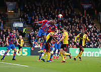 7th March 2020; Selhurst Park, London, England; English Premier League Football, Crystal Palace versus Watford; Christian Benteke of Crystal Palace and Gary Cahill of Crystal Palace both attempt to head the ball out from a Watford cross