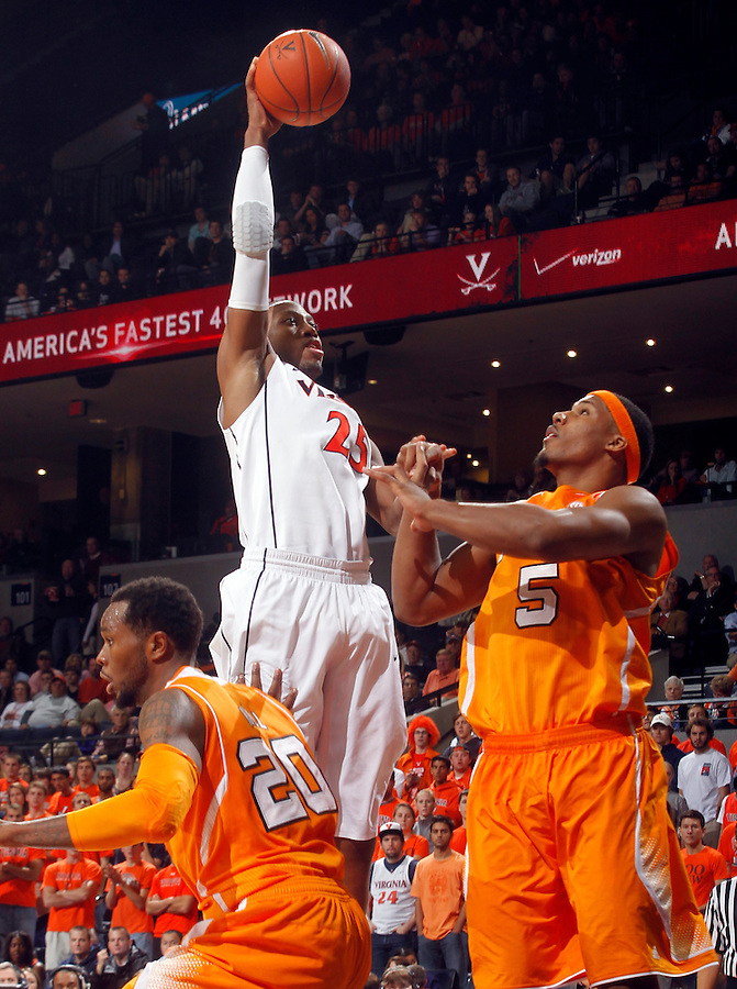 Virginia forward Akil Mitchell (25) shoots over Tennessee forward Jarnell Stokes (5) during the game Wednesday in Charlottesville, VA. Virginia defeated Tennessee 46-38.