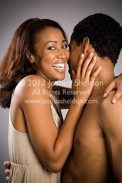 Young Hispanic couple embracing