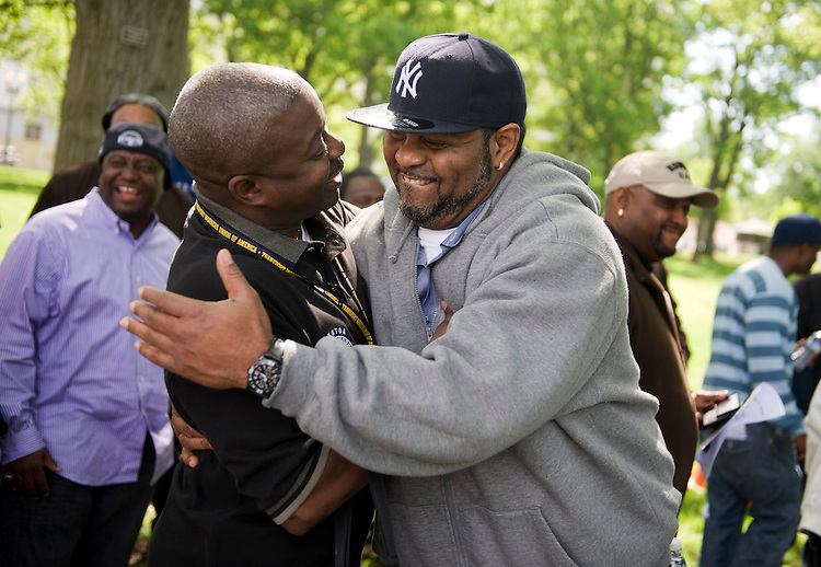 Kirk Martin, right, a bus driver from the Bronx, N.Y., hugs Frank Austin, executive board member of the Transport Workers Union of America (TWU), after a rally in Upper Senate Park, April 27, 2010.  Hundreds of TWU members from New York came to the Hill to talk to members of Congress on budget cuts in the transportation sector.