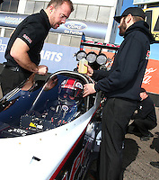 Feb 4, 2016; Chandler, AZ, USA; Crew members with NHRA top fuel driver Steve Torrence during pre season testing at Wild Horse Pass Motorsports Park. Mandatory Credit: Mark J. Rebilas-USA TODAY Sports