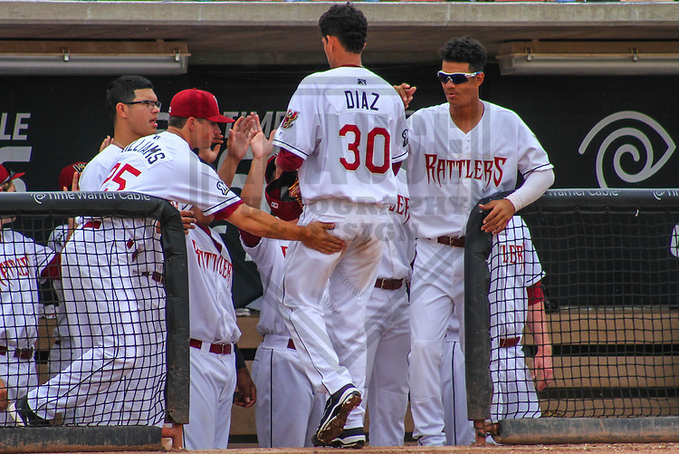 GRAND CHUTE - June 2014: Victor Diaz (30) of the Wisconsin Timber Rattlers is congratulated by teammates after leaving a game against the Burlington Bees on June 30th, 2014 at Fox Cities Stadium in Grand Chute, Wisconsin.  (Photo Credit: Brad Krause)