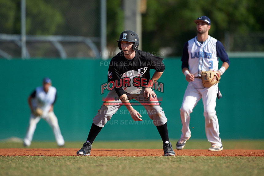 Edgewood Eagles Andrew Lauritzen (11) leads off second base in front of shortstop Hector Coscione (3) during the first game of a doubleheader against the Lasell Lasers on April 14, 2016 at Terry Park in Fort Myers, Florida.  Edgewood defeated Lasell 9-7.  (Mike Janes/Four Seam Images)