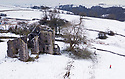 26/02/120<br /> <br /> After overnight snowfall a walker explores Throwley Old Hall. It is Staffordshire's only surviving example of a large medieval manor house. It is little known by all but those living in this picturesque corner of the Manifold Valley in the Peak District.<br /> <br /> Throwley was first recorded as a residence in 1203, when Oliver de Meverell settled here. It was probably a dwelling for years prior to that  and in the area around the Hall there are traces of a deserted medieval village.<br /> <br /> Drone flight was with all correct permissions etc.<br /> <br /> All Rights Reserved: F Stop Press Ltd.  <br /> +44 (0)7765 242650 www.fstoppress.com