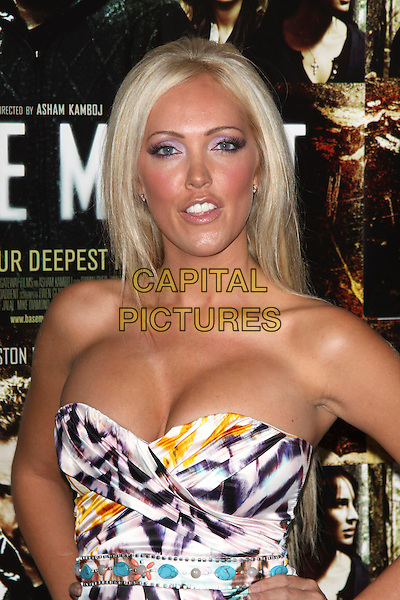 AISLEYNE HORGAN WALLACE .UK Film Premiere of 'The Basement' at The May Fair Hotel, London, England, UK, August 17th 2010.Mayfair half length  make-up strapless  white purple yellow print cleavage tanned .CAP/AH.©Adam Houghton/Capital Pictures.