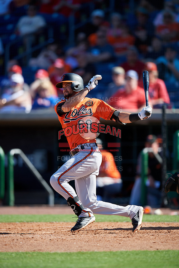 Baltimore Orioles shortstop Jack Reinheimer (69) follows through on a swing during a Grapefruit League Spring Training game against the Philadelphia Phillies on February 28, 2019 at Spectrum Field in Clearwater, Florida.  Orioles tied the Phillies 5-5.  (Mike Janes/Four Seam Images)