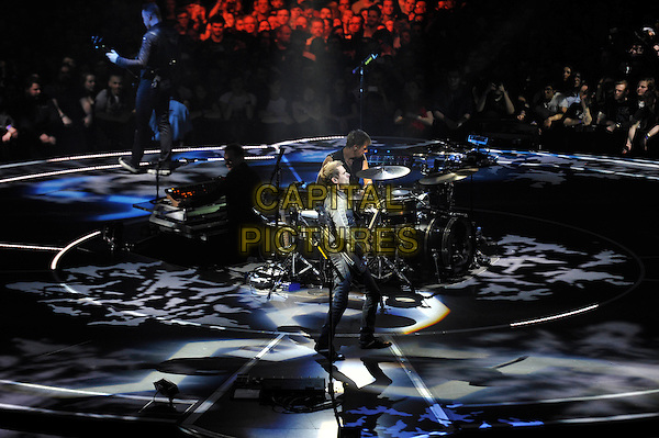 LONDON, ENGLAND - APRIL 3: Chris Wolstenholme, Dominic Howard and Matt Bellamy of 'Muse' performing at the O2 Arena on April 3, 2016 in London, England.<br /> * Press use only. No merchandising *<br /> CAP/MAR<br /> &copy;MAR/Capital Pictures