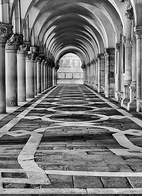 A travel photo of the view from under the arcade of the Doges Palace, Venice, Italy.