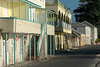 A number of buildings in traditional Barbados style along the waterfront in Speightstown.