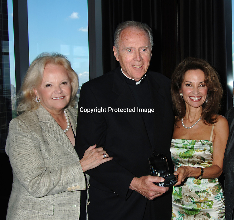 Jane Pontarelli, Father Emmet Fagan and Susan Lucci ..at The Rose Luncheon honoring Susan Lucci and Jane ..Pontarelli on June 13, 2006 at the Mandarin Oriental Hotel. ..The Rose Luncheon is benefitting Little Flower Children and ..Family Services of New York. ..Robin Platzer, Twin Images