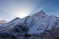 The sun rises behind Nuptse (25,850 ft./7879 m.) in the Khumbu Valley, Nepal.