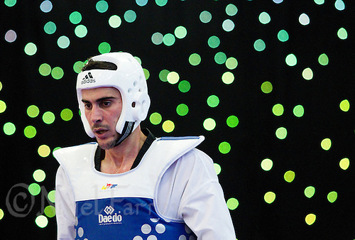 04 MAY 2012 - MANCHESTER, GBR - Konstantinos Gkoltsios (GRE) of Greece recovers during a break in his men's 2012 European Taekwondo Championships -87kg quarter final contest against Augustin Bata of France at Sportcity in Manchester, Great Britain (PHOTO (C) 2012 NIGEL FARROW)