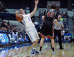 February 14, 2015 - Colorado Springs, Colorado, U.S. -  Air Force guard, Zach Kocur #5, is fouled during an NCAA basketball game between the UNLV Runnin' Rebels and the Air Force Academy Falcons at Clune Arena, U.S. Air Force Academy, Colorado Springs, Colorado.  Air Force defeats UNLV 76-75.