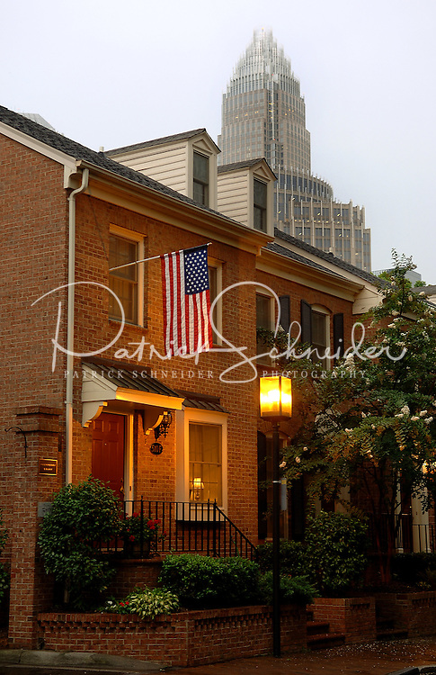 An American flag flies outside of a townhouse in uptown Charlotte, NC.