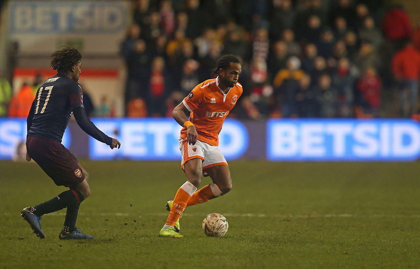 Blackpool's Nathan Delfouneso and Arsenal's Alex Iwobi<br /> <br /> Photographer Stephen White/CameraSport<br /> <br /> Emirates FA Cup Third Round - Blackpool v Arsenal - Saturday 5th January 2019 - Bloomfield Road - Blackpool<br />  <br /> World Copyright © 2019 CameraSport. All rights reserved. 43 Linden Ave. Countesthorpe. Leicester. England. LE8 5PG - Tel: +44 (0) 116 277 4147 - admin@camerasport.com - www.camerasport.com