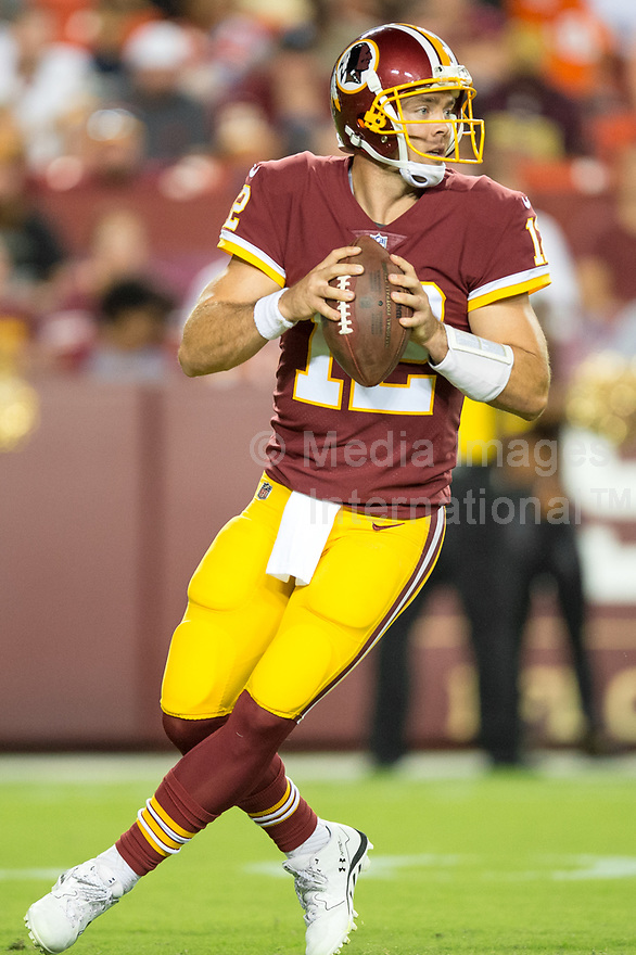 Landover, MD - August 24, 2018: Washington Redskins quarterback Colt McCoy (12) drops back for a pass during preseason game between the Denver Broncos and Washington Redskins at FedEx Field in Landover, MD. The Broncos defeat the Redskins 29-17. (Photo by Phillip Peters/Media Images International)