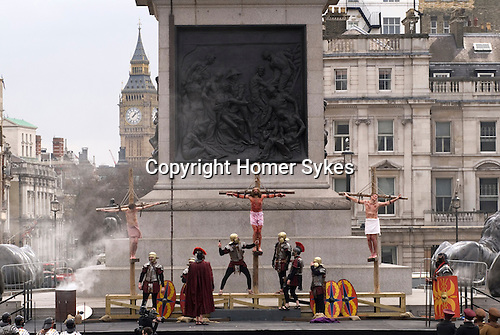 "Good Friday, Passion Play ""Passion in the Square"" Trafalgar Square thousands gather to watch annual performance by the Wintershall Players. London UK. James Burke-Dunsmore play the lead role in the play ""The Passion of Jesus"". 29th March 2013."
