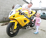Alan Connor and His daughter Méibh with the bike he will be racing at the Isle of Man TT....Photo NEWSFILE/Jenny Matthews.(Photo credit should read Jenny Matthews/NEWSFILE)....This Picture has been sent you under the condtions enclosed by:.Newsfile Ltd..The Studio,.Millmount Abbey,.Drogheda,.Co Meath..Ireland..Tel: +353(0)41-9871240.Fax: +353(0)41-9871260.GSM: +353(0)86-2500958.email: pictures@newsfile.ie.www.newsfile.ie.FTP: 193.120.102.198.