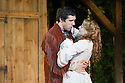 London, UK. 20.07.2015. Regent's Parks Open Air Theatre presents SEVEN BRIDES FOR SEVEN BROTHERS, directed by Rachel Kavanaugh. Picture shows: Laura Pitt-Pulford (Milly) and Alex Gaumond (Adam). Photograph © Jane Hobson.