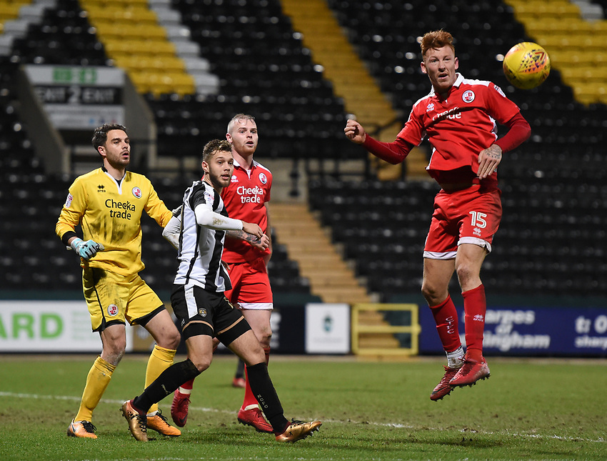 Crawley Town&rsquo;s Lee Holmes heads the ball with Crawley Town&rsquo;s Glenn Morris, Jorge Grant  <br /> <br /> Photographer Jon Hobley/CameraSport<br /> <br /> The EFL Sky Bet League Two - Notts County v Crawley Town - Tuesday 23rd January 2018 - Meadow Lane - Nottingham<br /> <br /> World Copyright &copy; 2018 CameraSport. All rights reserved. 43 Linden Ave. Countesthorpe. Leicester. England. LE8 5PG - Tel: +44 (0) 116 277 4147 - admin@camerasport.com - www.camerasport.com