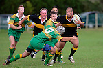 Bombay centre E. Poa about to be tackled by his opposite C. Anderson. Counties Manukau Premier Club Rugby, Drury vs Bombay played at the Drury Domain, on the 14th of April 2006. Bombay won 34 - 13.