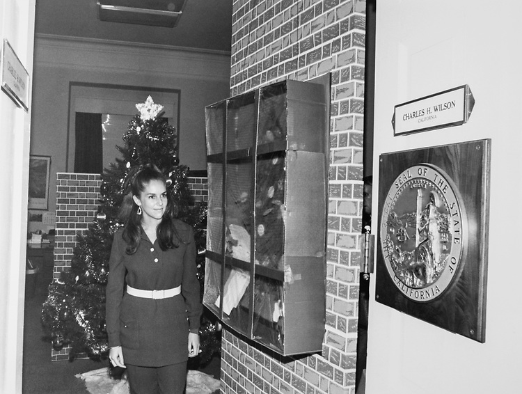 Staff member at Rep. Charles H. Wilson, D-Calif., decorated office around Christmas. (Photo by Dev O'Neill/CQ Roll Call via Getty Images)