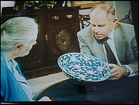 BNPS.co.uk (01202 558833)<br /> Pic: Hansons/BNPS<br /> <br /> A female relative of Robertson took the plate on the Antiques Roadshow in the 1990's.<br /> <br /> A rare 18th century Chinese plate which was languishing at the back of a kitchen cupboard has sold at auction for a whopping &pound;275,000.<br /> <br /> The antique, which carries the reign mark for Emperor Yongzheng (1723-1735), had been tucked away in a box at a home in South Derbyshire since its owners inherited it from their grandmother two years ago.<br /> <br /> Their grandmother hung the plate on her wall with a metal plate mount around it which has now been removed.<br /> <br /> The plate had attracted major interest in China with several potential Chinese buyers visiting the auction house to take a closer look before the sale.