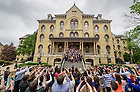 May 17, 2015; Graduates toss their caps in the air on the steps of the Main Building as family and friends gather to capture the moment. (Photo by Barbara Johnston/University of Notre Dame)