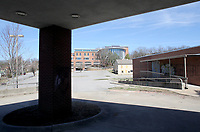NWA Democrat-Gazette/DAVID GOTTSCHALK The Old City Hospital and the Fayetteville Public Library are visible Monday, March 5, 2018. The Library Board is in the design stages of expansion on properties that includes the Old City Hospital.
