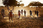 Darfuri boys play a game of football in Klaimendo village in North Darfur, 04 Dec, 2008. Despite the fact that North Darfur is believed to currently have the highest concentration of NGOs in the world, the creation of Klaimendo district and village is the work of people born and raised in the area, rather than an outside aid agency. (John D McHugh)