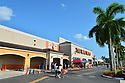 PEMBROKE PINES, FLORIDA - APRIL 19: Customers line up outside wearing face masks to enter Home Depot Home improvement store as they struggle to stay open during the Coronavirus (COVID-19) pandemic. As states trying to figure out the right protocol to put in place another to re-open the US economy and the country on April 19, 2020 in Pembroke Pines Florida.  ( Photo by Johnny Louis / jlnphotography.com )