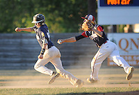 Quakertown's Tyler Guidos (left) avoids the tag of Oley/Topton Post 217's Ben Flicker while caught in a rundown in the third inning of the Region 2 American Legion Playoffs Sunday July 17, 2016 at Quakertown Memorial Park in Quakertown, Pennsylvania. Quakertown defeated Oley/Topton Post 217 12-0. (Photo by William Thomas Cain)