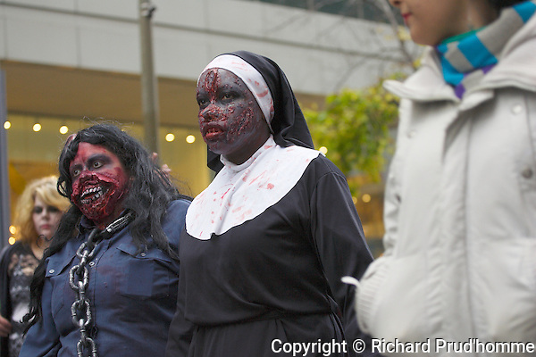 A bloodied dressed nun participates in the Montreal zombie walk