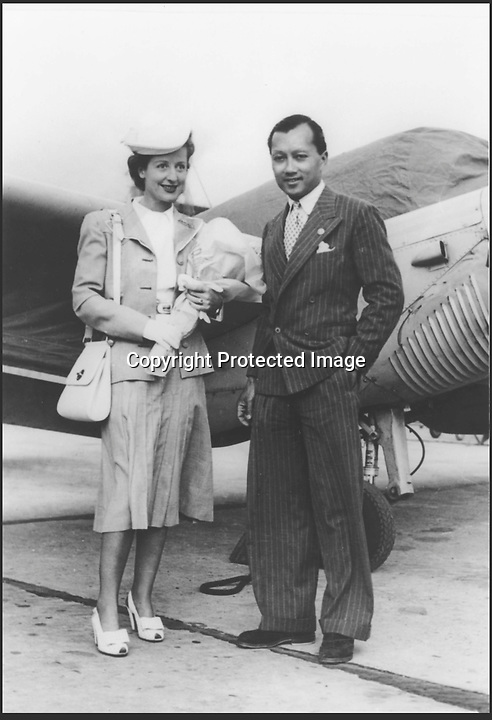BNPS.co.uk (01202 558833)<br /> Pic: Sothebys/BNPS<br /> <br /> Prince and Princess Birabongse on a visit to Thailand in the 1930's.<br /> <br /> English Rose who became a Thai Princess.<br /> <br /> A set of beautiful jewels given by a dashing young Siamese Prince to his english rose wife are being auctioned by Sothebys in London.<br /> <br /> In an echo of the famous Hollywood musical The King and I, English lady Ceril Heycock met and married Prince Bira (grandson of the Yul Brynner King) when only 17 in 1937 - the Eton educated Prince had just won the Monaco Grand Prix the year before and lavished his young bride with exotic jewels.<br /> <br /> Sothebys are selling the unique collection of diamonds, opals and pearls on thursday with a &pound;60,000 estimate.