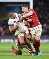 Jonathan Joseph of England is double-tackled. Natwest 6 Nations match between England and Wales on February 10, 2018 at Twickenham Stadium in London, England. Photo by: Patrick Khachfe / Onside Images