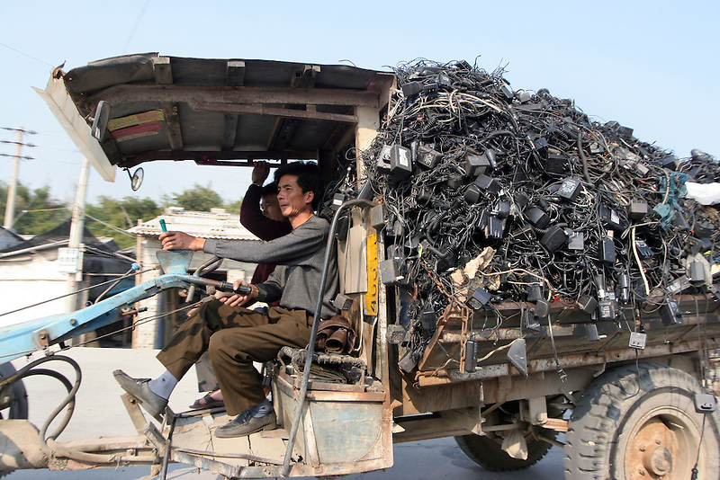 A truck load of electronic trash in Guiyu, China, March 8, 2005. For years, developed countries have been exporting tons of electronic waste to China for inexpensive, labor-intensive recycling and disposal.