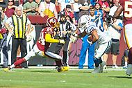 Landover, MD - September 16, 2018: Indianapolis Colts running back Jordan Wilkins (20) avoids Washington Redskins defensive back Josh Norman (24) during the  game between Indianapolis Colts and Washington Redskins at FedEx Field in Landover, MD.   (Photo by Elliott Brown/Media Images International)