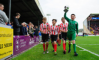 Lincoln City's under 12 side who won a Bradford Fire Memorial tournament parade the trophy at half time<br /> <br /> Photographer Chris Vaughan/CameraSport<br /> <br /> Vanarama National League - Lincoln City v Macclesfield Town - Saturday 22nd April 2017 - Sincil Bank - Lincoln<br /> <br /> World Copyright &copy; 2017 CameraSport. All rights reserved. 43 Linden Ave. Countesthorpe. Leicester. England. LE8 5PG - Tel: +44 (0) 116 277 4147 - admin@camerasport.com - www.camerasport.com