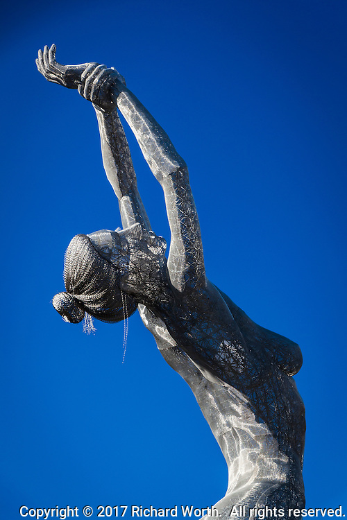 Truth is Beauty - the sculpture of a nude woman with arms and gaze aimed skyward at the San Leandro Tech Campus