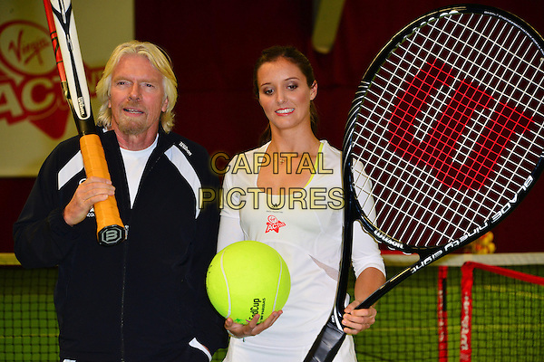 Sir Richard Branson & Laura Robson .Press conference & photocall where British tennis star, Laura Robson, becomes Virgin Active's first tennis ambassador & the face of Virgin Active's Junior Tennis Academy, Virgin Active Chiswick Riverside, London, England..February 26th, 2013.half length tracksuit giant large oversized racquets black white goatee facial hair court.CAP/BF.©Bob Fidgeon/Capital Pictures.