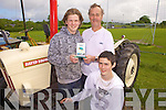 Winners of the vintage tractor competition last Sunday afternoon at the field day held in Tarbert as part of the Cailin Ban festival, l-r Kieran, Norman and Aiden Parkinson from Tarbert...++Aiden spelt with an E++