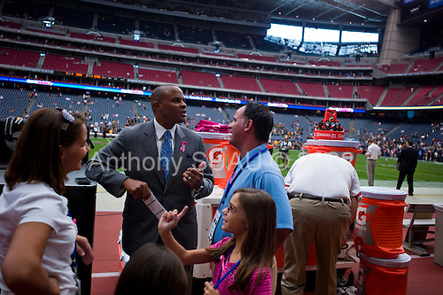 Houston, Texas<br /> October 2, 2011<br /> <br /> Greeting friends on the sidelines of the stadium's field, general manager and first as executive vice president, Rick Smith oversees all aspects of football operations. Smith has strengthened Houston's roster through the draft, free agency and several trades at key positions.<br /> <br /> The Houston Texans defeated the Pittsburgh Steelers at the Reliant Stadium 17 to 10.