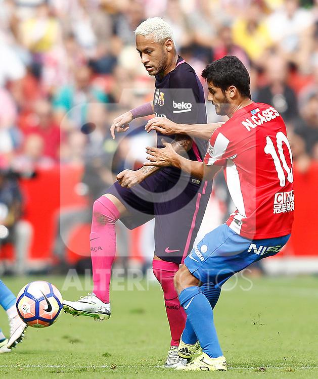 Sporting de Gijon's Nacho Cases (r) and FC Barcelona's Neymar Santos Jr during La Liga match. September 24,2016. (ALTERPHOTOS/Acero)