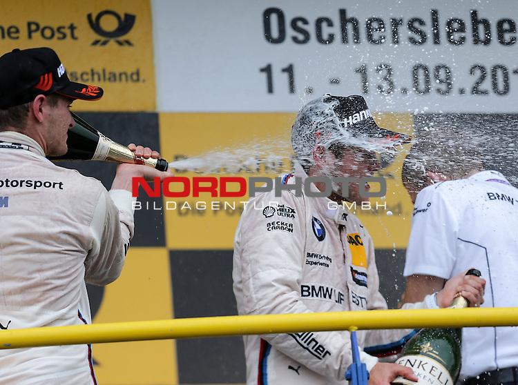 DTM 2015, 07.Lauf Oschersleben, 11.09. - 13.09.15 <br /> Podium:<br /> Feiert seinen ersten Sieg in der DTM Tom Blomqvist (SWE#31) BMW Team RBM BMW M4 DTM mit einer Champagnerdusche,Marco Wittmann (DEU#1) BMW Team RMG BMW M4 DTM <br /> <br /> <br /> <br /> <br /> Foto &copy; nordphoto /  Bratic